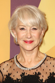 Helen Mirren added some elegant sparkle with a Harry Winston diamond necklace and matching earrings.
