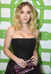 Sydney Sweeney opted for a dark brown mani to finish off her look.