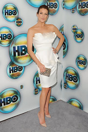 Kate Walsh added a splash of sparkle to her white strapless dress with a jewel studded clutch.