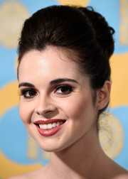 Vanessa Marano was '60s-glam with this high-volume pompadour bun at the HBO Golden Globes party.