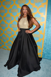 Beverly Johnson looked totally party-ready in a ballgown with a beaded gold bodice during the HBO Golden Globes event.