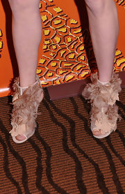 Amanda Seyfried wore feather embellished sandals to the HBO Golden Globe party.