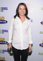 Patty Smyth looked laid-back yet classic in a white button-down shirt with tiny ruffles down the front.