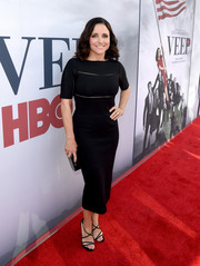 Julia Louis-Dreyfus styled her dress with sexy strappy sandals.