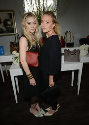 Ashley Olsen attended the Elizabeth and James collection party carrying a simple yet stylish rust-colored fur clutch.