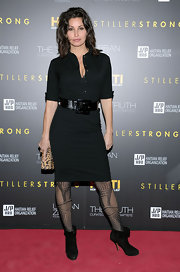 Gina Gershon's LBD looked so much chicer with the addition of black ankle boots and patterned tights.