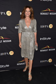 Allison Janney looked fab in a shimmering silver wrap dress at the HFPA and InStyle TIFF celebration.