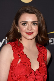 Maisie Williams swiped on some red lipstick to match her outfit.