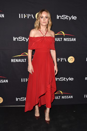 Brie Larson looked party-perfect in a red cold-shoulder halter dress and matching trousers by Yigal Azrouel at the HFPA and InStyle TIFF celebration.