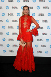 Petra Nemcova amped up the allure in a partially sheer red lace gown by Jonathan Simkhai at the HP Global Citizen Evening during the Cannes Film Festival.