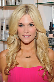 Tinsley Mortimer wore her ultra-long hair in layered waves while celebrating her new novel.
