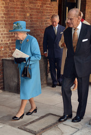 Queen Elizabeth II chose a blue evening coat and a matching embellished hat for the christening of Prince George.