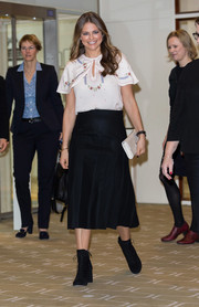 Princess Madeleine styled her outfit with black lace-up boots by Miu Miu.