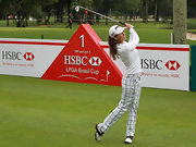 Azahara Munoz took a swing on the golf course in a pair of white and blue plaid pants.