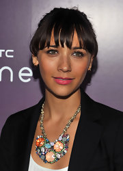 Rashida Jones attended the HTC serves up NYC product launch event wearing bold pink lipstick. To recreate her look, we recommend a product like Bobbi Brown Rich Lip Color in Cosmic Raspberry.