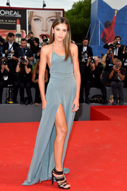 Sistine Rose Stallone flashed some side cleavage and plenty of leg in this slate-blue halter gown during the Venice Film Festival premiere of 'Hacksaw Ridge.'