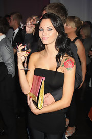Jane Clement has a large red rose tattoo design on her left shoulder.