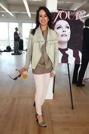 Haley Binn stuck to neutral colors when she paired this pair of nude skinny pants with a light brown blouse and leather jacket.