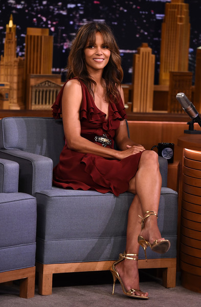 Halle Berry Evening Sandals [halle berry,the tonight show starring jimmy fallon,leg,clothing,thigh,human leg,sitting,human body,muscle,long hair,brown hair,dress,new york city,rockefeller center]