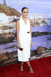 Cara Santana styled her LWD with a pair of black-and-white striped sandals.