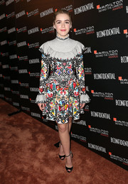 Kiernan Shipka donned a busy-looking Valentino print dress, featuring a high neckline, a ruffle yoke, and fluted cuffs, for the Hamilton Behind the Camera Awards.