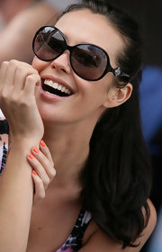 Megan Gale attended the BYO pool party wearing a pair of oversized round sunnies.