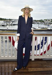 Karolina Kurkova was masculine-chic in a navy pinstriped pantsuit by La Ligne during her Hamptons Magazine cover celebration.