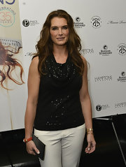 Brooke Shields added a pop of color to her outfit at the Hamptons Magazine Memorial Day Issue launch with an orange leather studded bracelet.