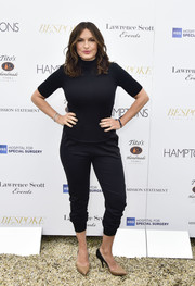 Mariska Hargitay matched her top with black Mission Statement track pants, which she wore pulled up to her calves.