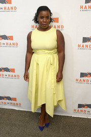 Uzo Aduba was bold with her colors, pairing her yellow dress with blue pumps.