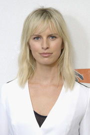 Karolina Kurkova sported a casual-chic layered cut with choppy bangs at the Hand in Hand: A Benefit for Hurricane Relief.