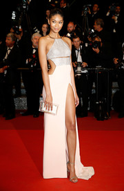 An acrylic box clutch with a white pouch polished off Chanel Iman's look.