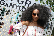 Kat Graham channeled the '70s with this afro at the Happiest of Hours event.
