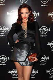 Jessica Sutta carried a hot hard case clutch fit for the Hard Rock Cafe opening night.