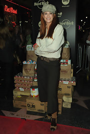 Angie Everhart donned tan suede boots with chocolate cap toes. She showcased the boots with wide legged cropped trousers.
