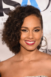 Alicia Keys looked gorgeous with her short, side-swept curls at the Harlem School of the Arts 50th anniversary event.