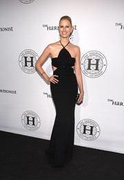 Karolina Kurkova looked ultra modern in a black halter gown with waist cutouts at the Harmonist cocktail party.