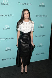 Demi Moore continued the punky vibe with a high-waisted black leather skirt, also by Monse.