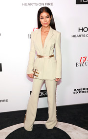 Jhene Aiko cut a strong silhouette in a pearl-embellished khaki pantsuit by Prabal Gurung at the Harper's Bazaar 150 Most Fashionable Women celebration.