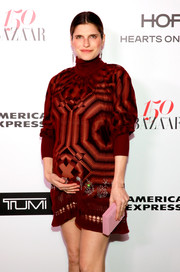 Lake Bell accessorized with a pink Lee Savage box clutch at the Harper's Bazaar 150 Most Fashionable Women celebration.