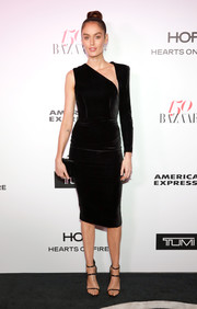 Nicole Trunfio's form-fitting one-sleeve dress at the Harper's Bazaar 150 Most Fashionable Women celebration was an ultra-modern take on the classic LBD.