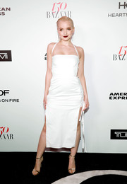 Dove Cameron styled her dress with gold ankle-strap sandals by Aldo.