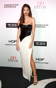 Emily Ratajkowski sheathed her curves in a high-slit two-tone strapless gown by Cristina Ottaviano for the Harper's Bazaar 150 Most Fashionable Women celebration.