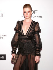 Ireland Baldwin paired a printed clutch with a sheer gown, both by Tadashi Shoji, for the Harper's Bazaar 150 Most Fashionable Women celebration.