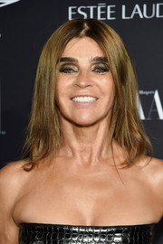 Carine Roitfeld sported a simple center-parted hairstyle at the Harper's Bazaar Icons event.