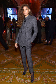 Zendaya Coleman went for an androgynous vibe in a gray pantsuit by Berluti at the Harper's Bazaar Icons event.