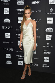 Josephine Skriver styled her dress with silver ankle-wrap sandals by Rene Caovilla.