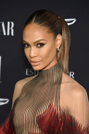 Joan Smalls styled her hair into a sleek ponytail for the 2018 Harper's Bazaar Icons event.