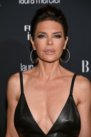 Lisa Rinna's loose ponytail at the Harper's Bazaar Icons event was a refreshing change from her signature layered razor cut.