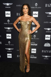 Shanina Shaik looked radiant in a strapless gold gown by Pamela Dennis at the 2018 Harper's Bazaar Icons event.